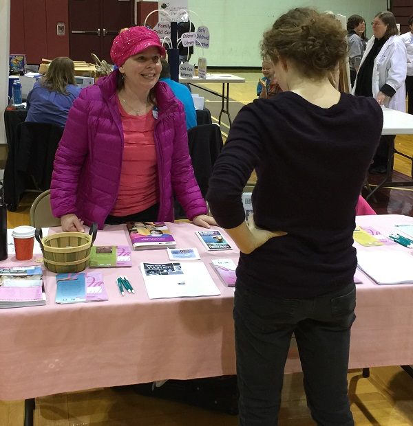 Patty chatting with a health fair attendee